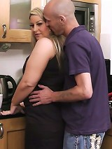 Fat blonde bends over for cock