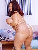 Pretty brunette BBW taking off her clothes and playing with her enormous knockers live