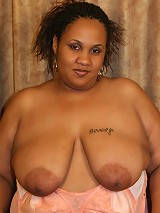Plump ebony Milk Shaker showing off her massive butt and takes pussy poking from a black hunk